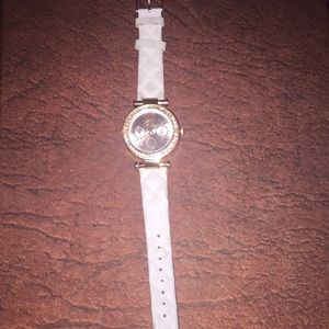 Woman's rose gold and light gray watch